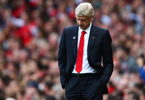 Ramsey bao ve thay Wenger truoc bao du luan hinh anh