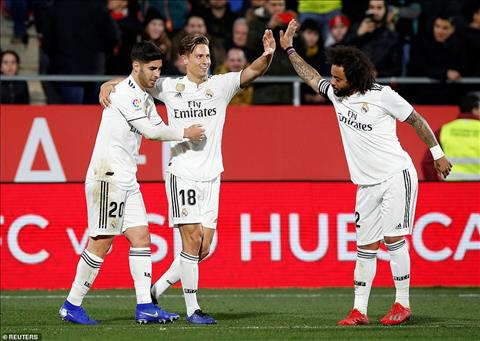 Llorente (giua) ghi ban con lai cho Real Madrid