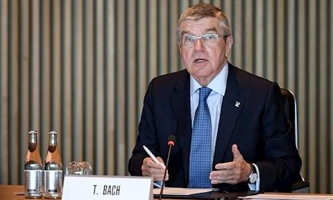 Chu tich IOC Thomas Bach hoi dam qua video voi Thu tuong Abe toi 24/3. Anh: AFP.