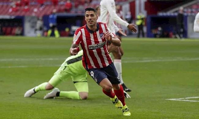 Suarez ghi bàn thứ 17 cho Atletico mùa này và bàn thứ 13 vào lưới Real trong sự nghiệp. Ảnh: AP.