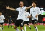 Duc 1-0 Anh: Loi chia tay ngot ngao cua tuong dai Podolski